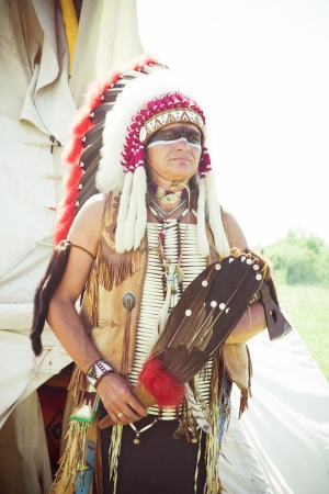 axes: North American Indian in full dress. Reconstruction