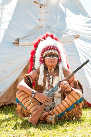 North American Indian in full dress. Reconstruction Stock Photo - 10269279