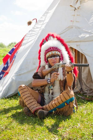 North American Indian in full dress. Reconstruction Stock Photo - 10269296