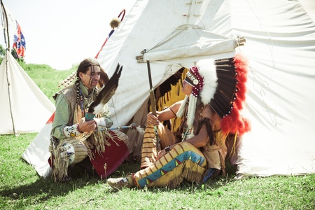 North American Indians sit at a wigwam Stock Photo - 10269290