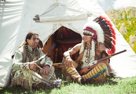 North American Indians sit at a wigwam Stock Photo - 10269284