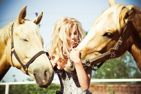 outdoor portrait of young beautiful woman with horse photo