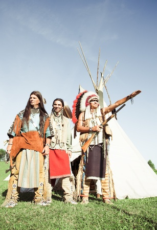 Group of North American Indians about a wigwam Stock Photo - 10269283