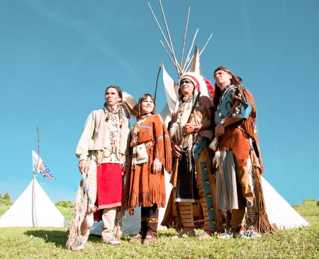 indian people: Group of North American Indians about a wigwam