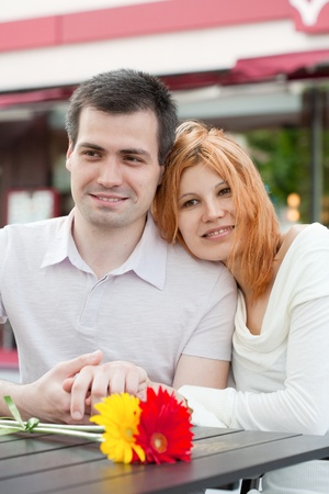 happy young couple in a cafe photo