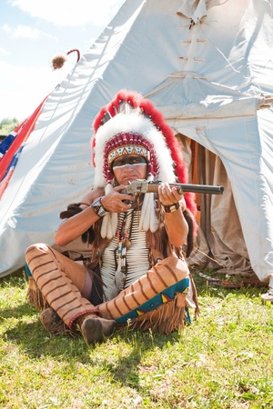 North American Indian in full dress. Reconstruction Stock Photo - 10292950