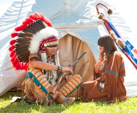 Group of North American Indians about a wigwam Stock Photo - 10292969