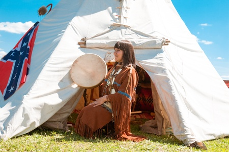 swarty: North American Indian girl  in full dress. Reconstruction Stock Photo