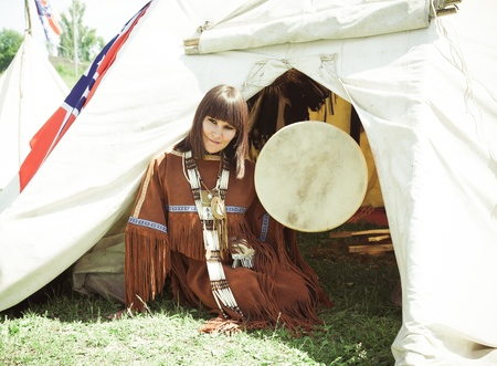 aboriginal woman: North American Indian girl  in full dress. Reconstruction Stock Photo