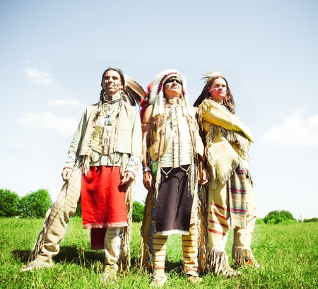 Group of North American Indians about a wigwam Stock Photo - 10292826