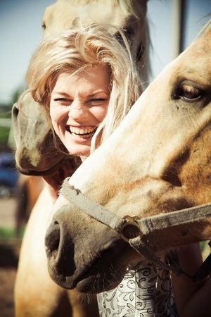 horse blonde: outdoor portrait of young beautiful woman with horse Stock Photo
