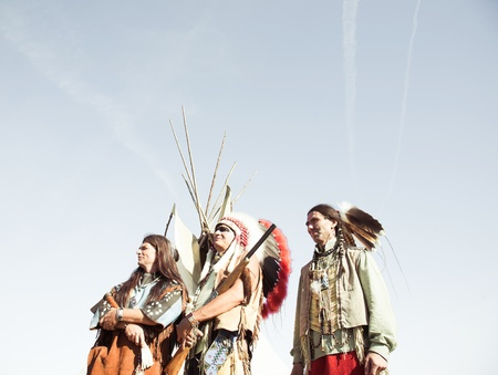 Group of North American Indians about a wigwam photo