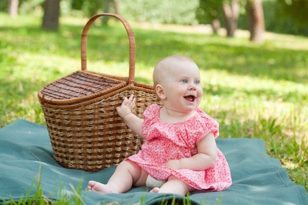 Summer portrait of beautiful baby on the lawn photo