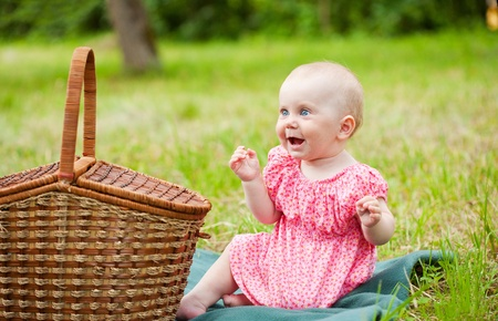 Summer portrait of beautiful baby on the lawn Stock Photo - 10458779