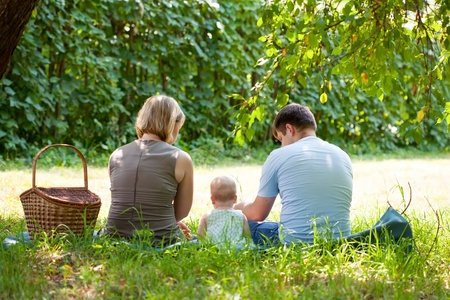 Family having picnic in park photo
