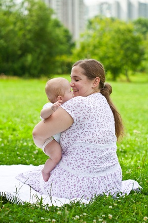 Young mum walks with the child in city park Stock Photo - 10503336