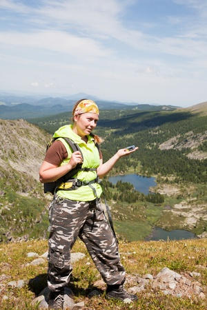 girl -  tourist in mountains is guided on a compass Stock Photo - 10604132
