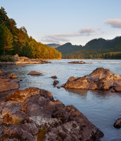 Beautiful evening landscape with the river and stones photo