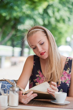 suntanned: beautiful girl has a rest in street cafe in park Stock Photo