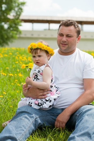 father with a daughter walk in a summer garden photo