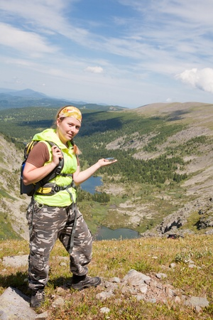 tourist in mountains with a compass in a hand Stock Photo - 11008999