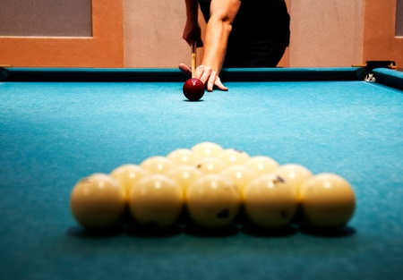 Man Plays Billiards The Moment Of Breakdown Of Spheres Stock Photo - Pool table breakdown