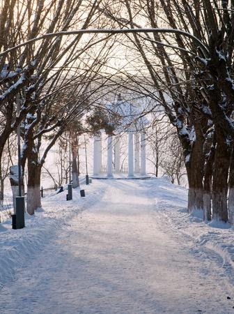 Winter landscape with avenue and a rotunda
