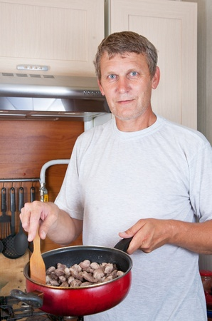 mature man makes to itself a supper photo