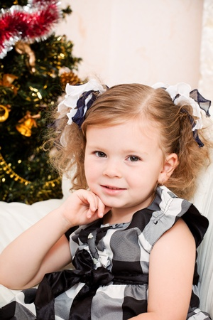 little girl at a Christmas fir-tree. Stock Photo - 11034149