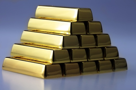 ingots of gold combined by a pyramid photo
