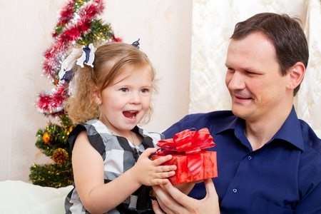Merry Christmas - little girl with  father with Christmas gifts Stock Photo - 11195275
