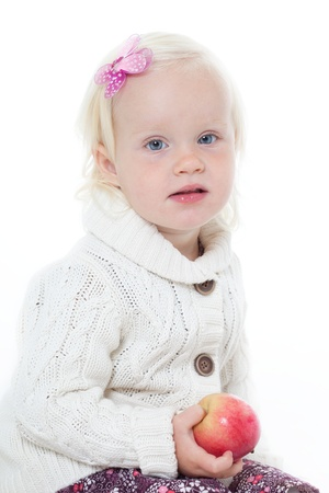 little girl in a knitted jacket on a white background Stock Photo - 11195224