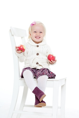 little girl in a knitted jacket on a white background Stock Photo - 11195203