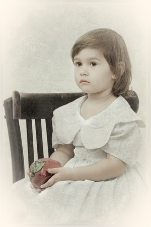 girl in an elegant dress sits on a chair. Processing in style of a retro. photo