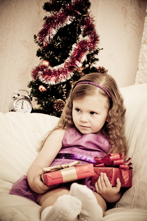 little girl at a Christmas fir-tree. Stock Photo - 11353557