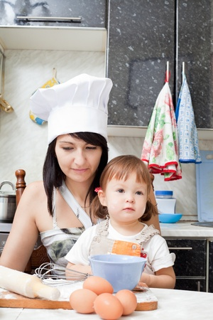 Mum with the daughter make together a dinner Stock Photo - 11353581
