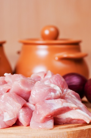 suppression: cut meat and the vegetables, prepared for suppression in pots. Stock Photo