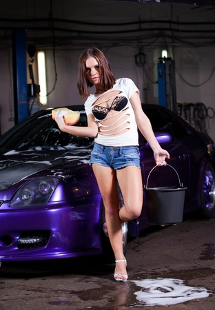 beautiful girl washes the car photo