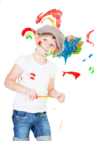 bedaubed: girl in a white T-shirt and a cap bedaubed with bright paints