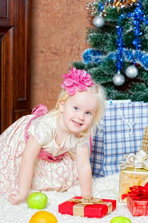 christmas eve: little girl at a Christmas fir-tree