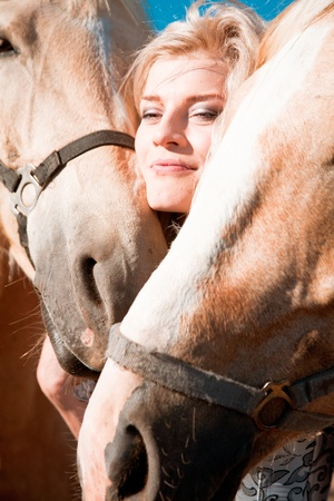 outdoor portrait of young beautiful woman with horse Stock Photo - 12393186