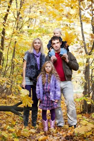 4 5 year old: Family Enjoying Walk In Park