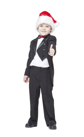 boy in a tuxedo and a cap Santa Claus on a white background Stock Photo - 12720130