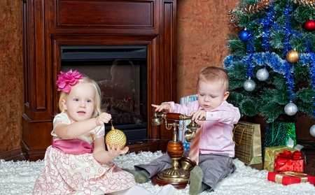 Happy children at a Christmas fur-tree Stock Photo - 11693431