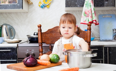 helps: little girl helps to make a dinner
