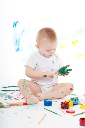 boy bedaubed with bright colors photo