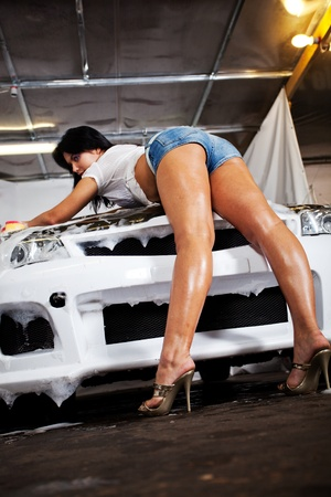 beautiful girl washes the car Stock Photo - 12332439