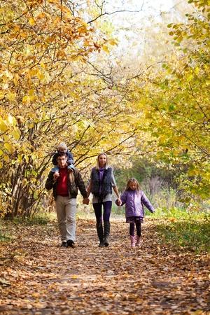 Family Enjoying Walk In Park Stock Photo - 12332492