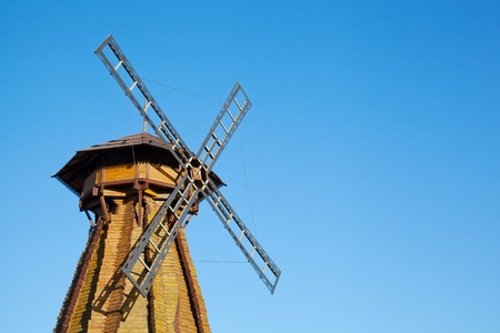 watermanagement: Old wooden mill against the blue sky Stock Photo