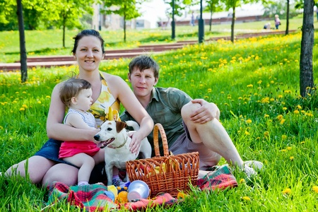 Family picnicking together photo